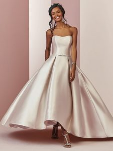 model walking with a champagne wedding dress example