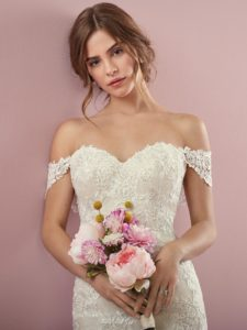 modem in an ivory wedding dress holding flowers